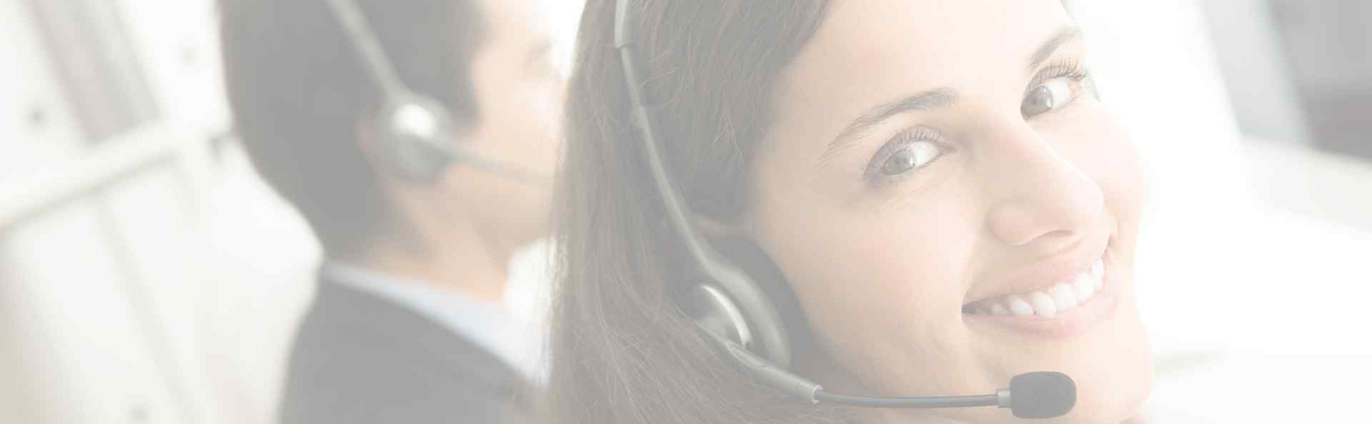 a happy customer services girl wearing headset responding to customers