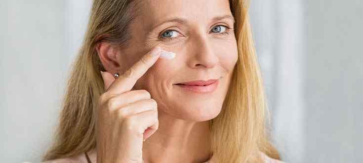 a happy women using estrogen to rejuvenate her skin